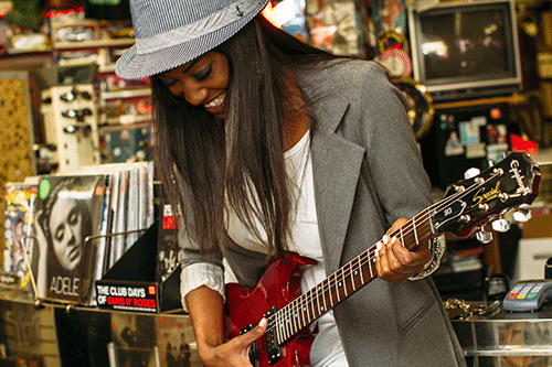 Woman on guitar