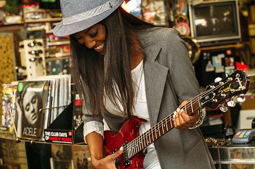 Woman on guitar